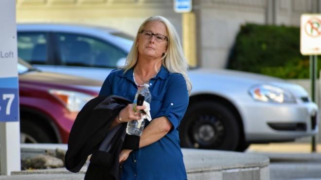 Ex-St. Louis police officer Lori Wozniak leaves court on November 5. - DOYLE MURPHY