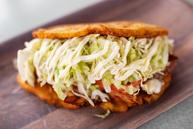 Jibarito with your choice of steak or pork, Swiss-American cheese, lettuce, tomatoes and garlic mayo served on twice-fried green plantains. - MABEL SUEN