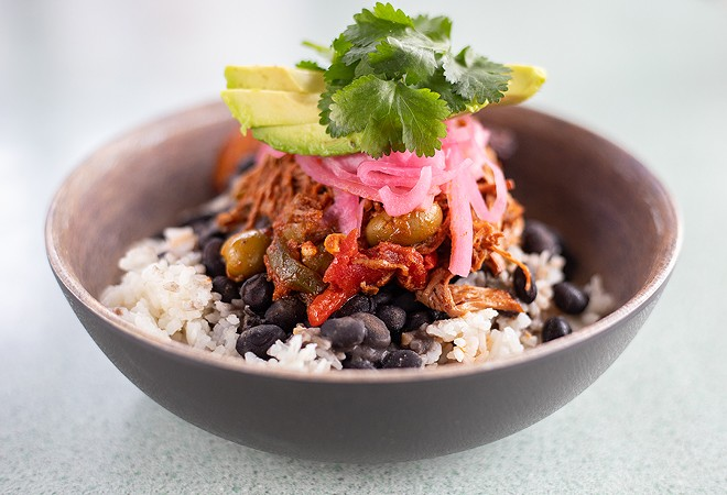 Ropa vieja with shredded slow-braised flank steak, black beans, white rice, pickled onion, maduros and avocado. - MABEL SUEN