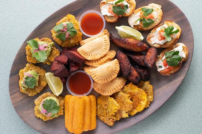 The restaurant's appetizer sampler features tostones with avocado, fried salami, cheese empanadas, maduros, Cuban bruschetta and sorullitos. - MABEL SUEN