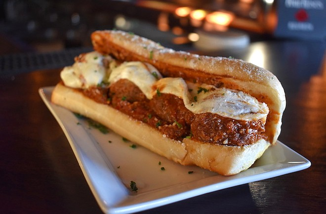 Cheesy meatball sub with hand-rolled meatballs, housemade red sauce and fresh mozzarella. - LIZ MILLER