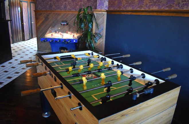 More focused on traditional bar games and board games than arcade or video games, the bar features a foosball table and a bubble hockey. - LIZ MILLER