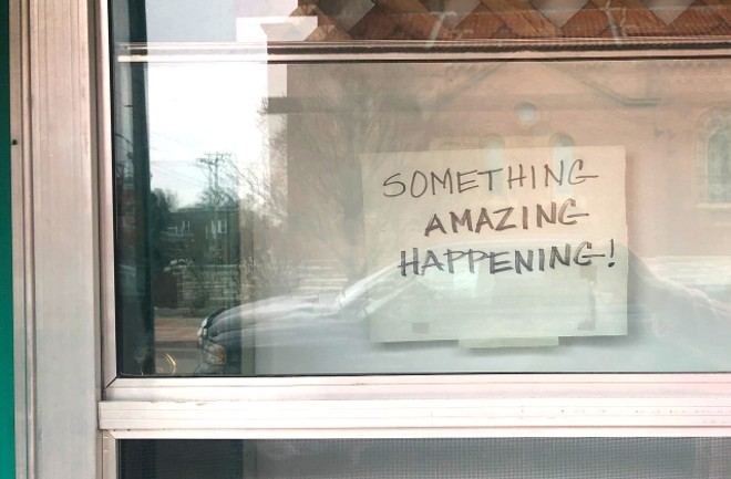 One of the signs now displayed in the window at 5141 Wilson Avenue. - LIZ MILLER