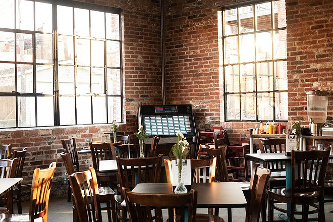 A lot of the restaurant's buzz relates to the space itself, divided into a takeout counter and pizza kitchen on one side and the main dining room and bar on the other. - MABEL SUEN
