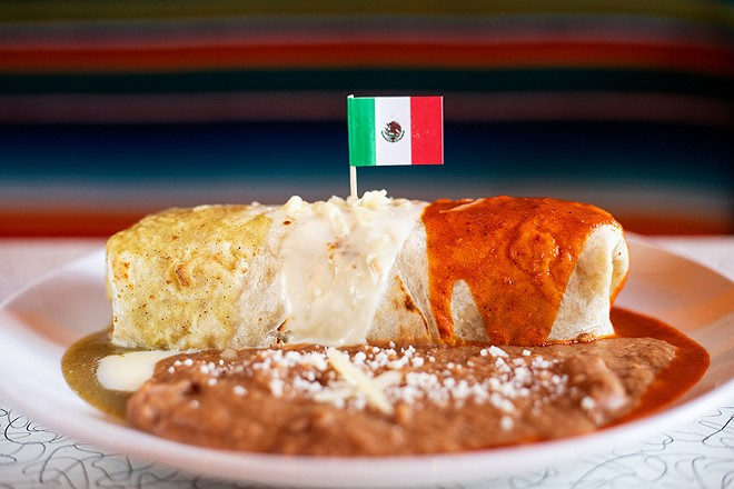 The Mexican Flag Burrito topped with salsa verde, queso blanco and salsa ranchero served with rice and beans. - MABEL SUEN