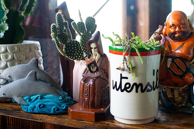 Decor in the dining room includes vibrant collectibles and cacti. - MABEL SUEN
