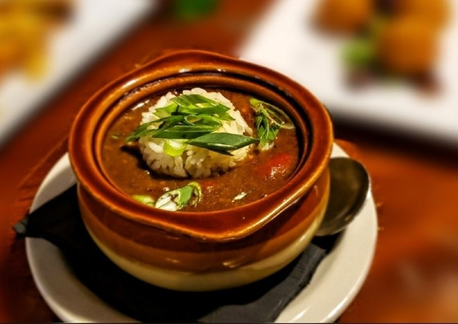 Carnival's menu pulls from Creole cuisine in dishes like this chicken-andouille gumbo. - KRISTEN FARRAH