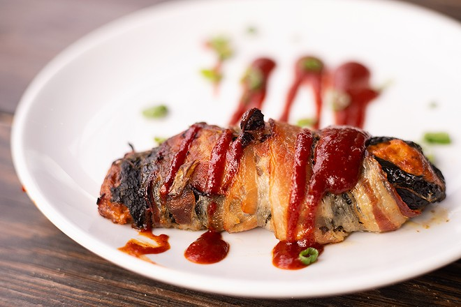 The Texas Twinkie wraps a poblano in bacon and stuffs it with brisket and cream cheese. - MABEL SUEN