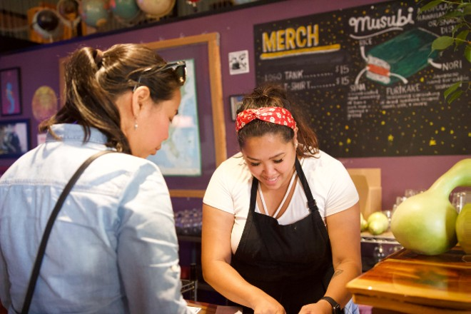 Charlene Lopez-Young behind the Fattened Caf counter at Earthbound. - COURTESY DARREN YOUNG AND CHARLENE LOPEZ-YOUNG