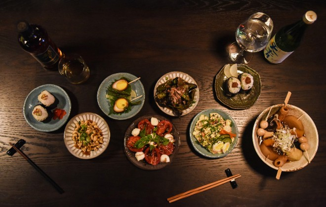 An overhead view of seven of the shareable plates at Takashima. - TRENTON ALMGREN-DAVIS