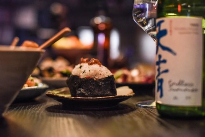 Umeboshi onigiri (pickled plum-flavored picnic rice). - TRENTON ALMGREN-DAVIS