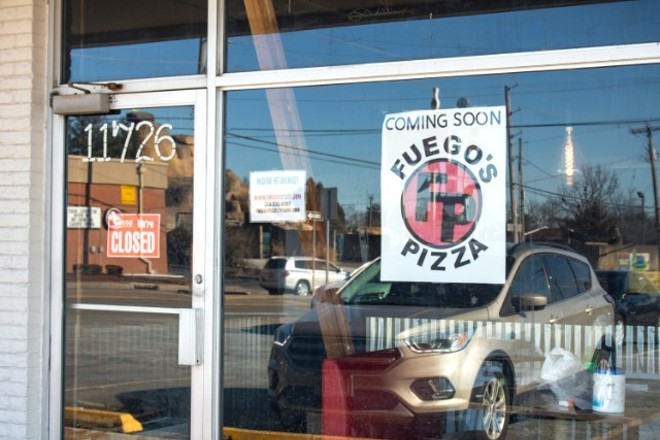 A sign announcing that Fuego's is coming soon has been posted in the window. - MONICA OBRADOVIC