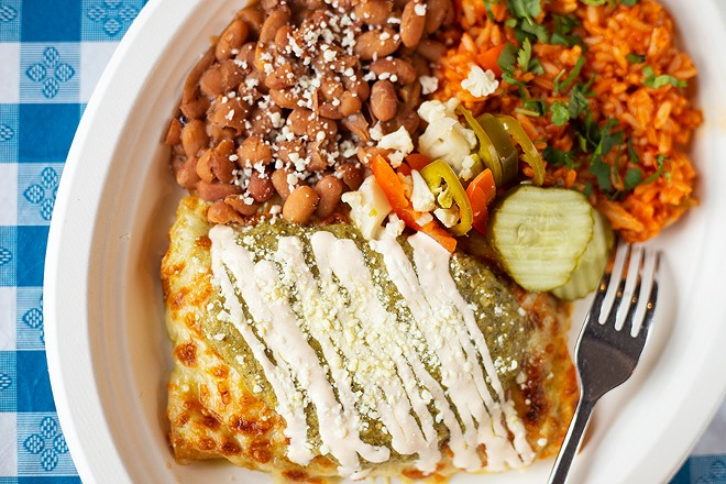 Chicken enchiladas with ricotta, cilantro and green sauce. - MABEL SUEN