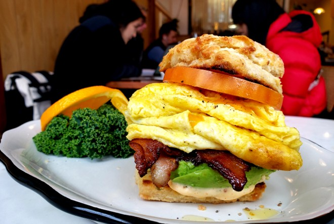 The house breakfast sandwich stuffs bacon, eggs and veggies between two biscuits. - KRISTEN FARRAH