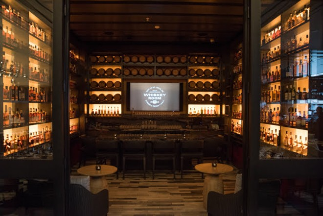 The Whiskey Room serves as a private event space and features a huge selection of bourbon, whiskey and rye at various price points. - TRENTON ALMGREN-DAVIS