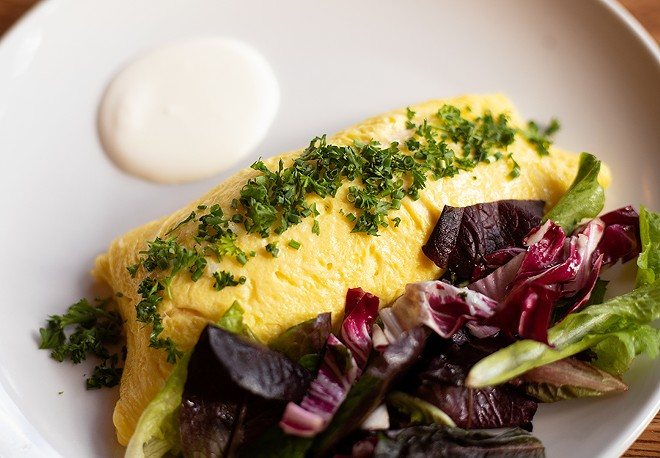 The crab omelet with Maine peekytoe crab, creme fraiche, fine herbs and petite greens. - MABEL SUEN