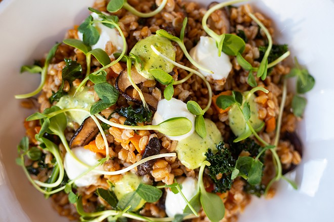 Grain salad with sweet potato, butternut squash, kale, shiitake mushrooms, goat cheese, green goddess and pea shoots. - MABEL SUEN