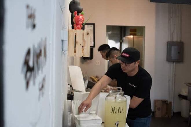 Owner Jimmy Trinh working in the kitchen. - TRENTON ALMGREN-DAVIS