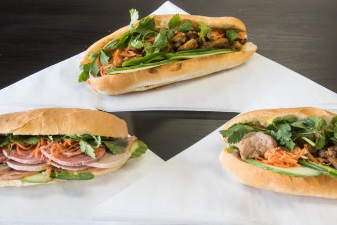 Sandwiches pictured from left to right: the Saigon Classic, grilled pork and lemongrass chicken. - TRENTON ALMGREN-DAVIS