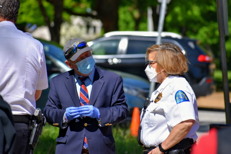 Stephen Conway talks to Capt. Renee Kriesmann at the edge a homeless camp before it was cleared away. - DOYLE MURPHY
