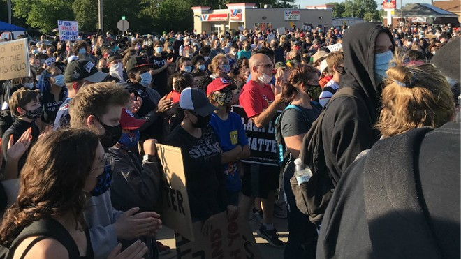 Protesters were back at Florissant police headquarters to demand charges against a detective who was fired for running down a man with his car. - MIKE FITZGERALD
