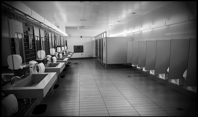 "The Chesapeake House Travel Plaza on I-95 in Port Deposit, Maryland, is void of people on Sunday night, March 22. ""I made the empty men's room image first because it immediately reminded me of the scene from The Shining."" - CHET GORDON"