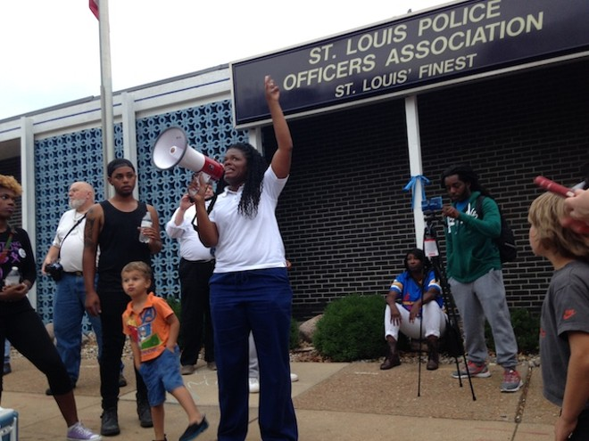 Cori Bush in 2017 leads protesters in a chant in front of the St. Louis Police Officers Association. - PHOTO BY DOYLE MURPHY