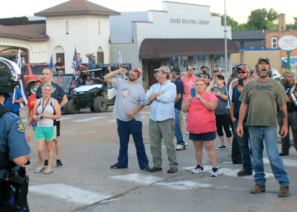 Activists at Fredericktown's June 24 protest were met with racist taunts from counterprotesters, like this gesture graphically depicting the act of lynching. - ADAM HAMLIN