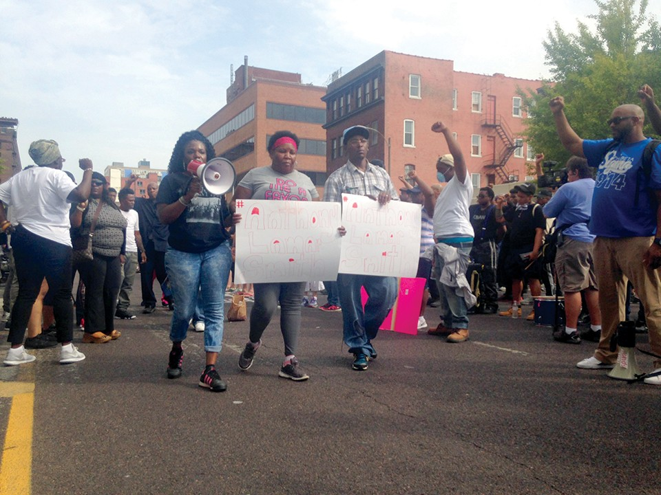 Cori Bush marches with the family of Anthony Lamar Smith, a Black man killed by a white St. Louis police officer. - DOYLE MURPHY