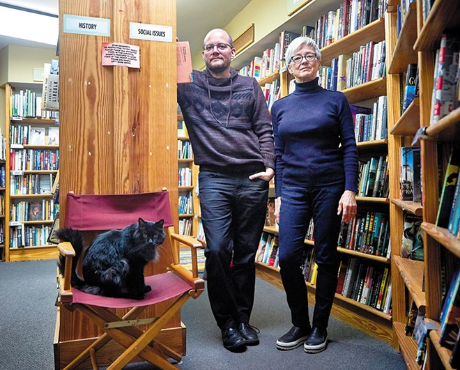 Left Bank Books co-owners Jarek Steele and Kris Kleindienst (with Spike, left) aren't just selling books. They're also creating community. - THEO WELLING