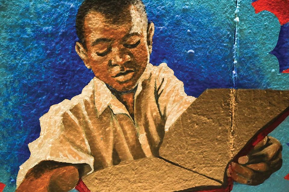 Ronald Burrow's portrait of a child reading a golden book. - NICHOLAS COULTER