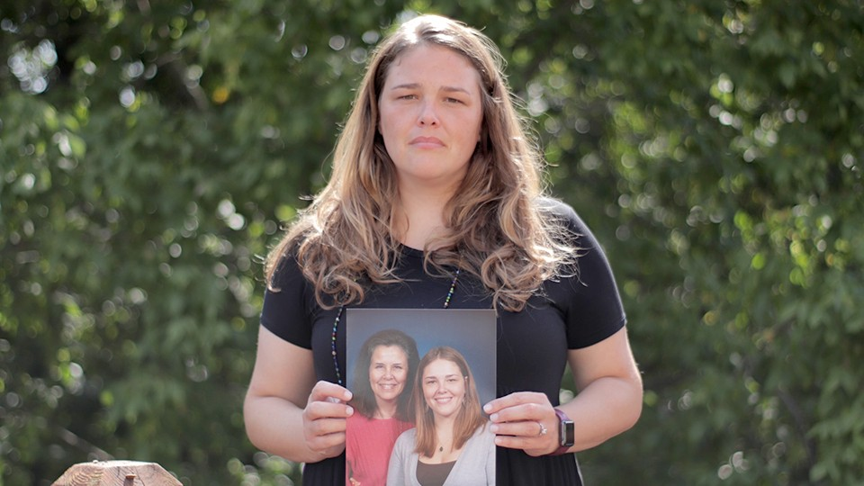 Angela Kender, holding a portrait of her mother, documents the toll COVID-19 has taken.
