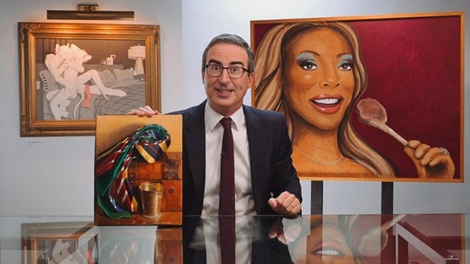 John Oliver poses with his exceptionally weird art collection at the close of Sunday's show. - SCREENSHOT VIA LAST WEEK TONIGHT