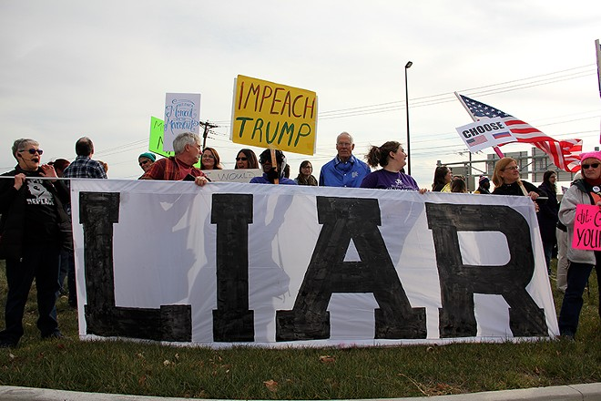 Trump's visit to St. Charles in March 2018 was met with protest. - DANNY WICENTOWSKI