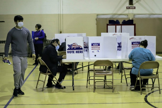 Voters casting their ballots before polls closed on Election Day. - STEVEN DUONG