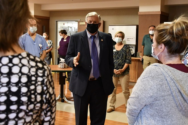 Governor Mike Parson tweeted this photo of himself meeting with staff on September 15 at Mount Vernon Veterans Home, which suffered a COVID-19 outbreak shortly after. - MIKE PARSON/TWITTER
