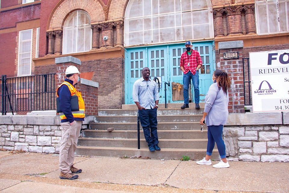 Kevin Bryant (center) of Kingsway Development aims to rehab the 127-year-old former Euclid School into senior apartments. - DANNY WICENTOWSKI
