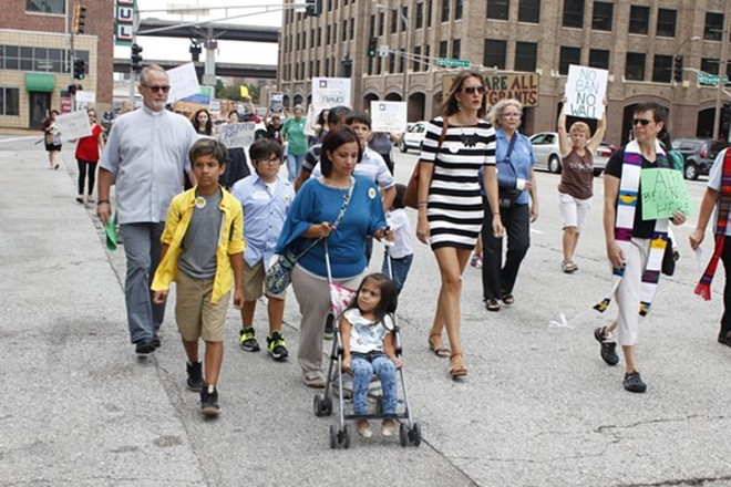 Carly Garcia and her family in September 2017 march in downtown St. Louis. - KATIE HAYES