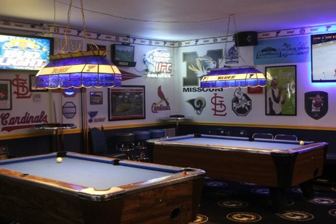 Bluenote's hockey themes pool tables. - CHERYL BAEHR