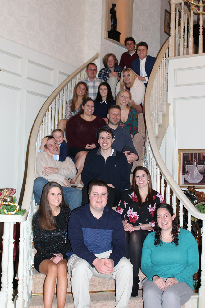 Christmas Eve Mass with all the cousins on the staircase of Margie and Ed Imo's house. - PHOTO COURTESY OF EMILY IMO