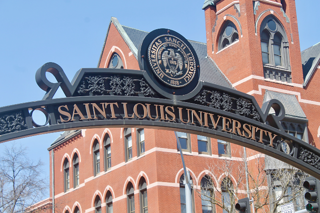 The iron arch donning Saint Louis University's name on West Pine and Grand Avenue. - RILEY MACK