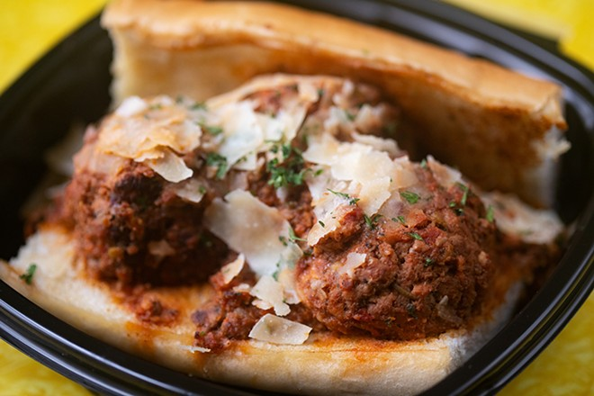 Smoked meatball sub with bolognese and shaved cheese. - MABEL SUEN