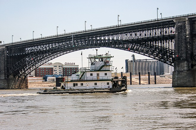 """A tugboat passes under the Eads bridge connecting Missouri and Illinois. Both states earned a """"C-"""" in infrastructure from the Biden administration. - DANNY WICENTOWSKI"""