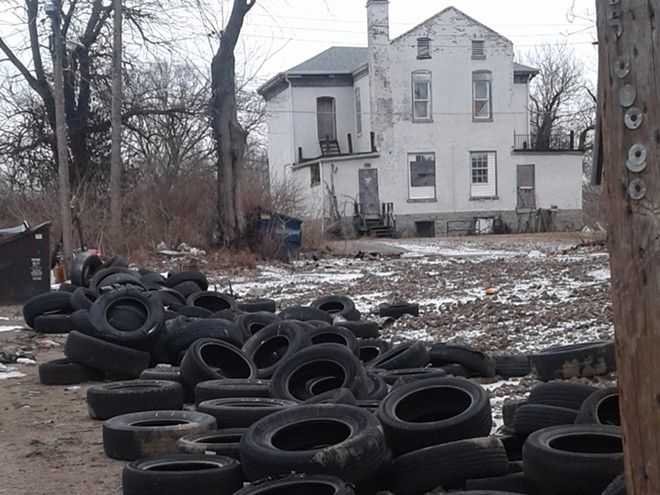 Piles of tires as they appeared in police photos of an illegal dumping site in north St. Louis. - SLMPD