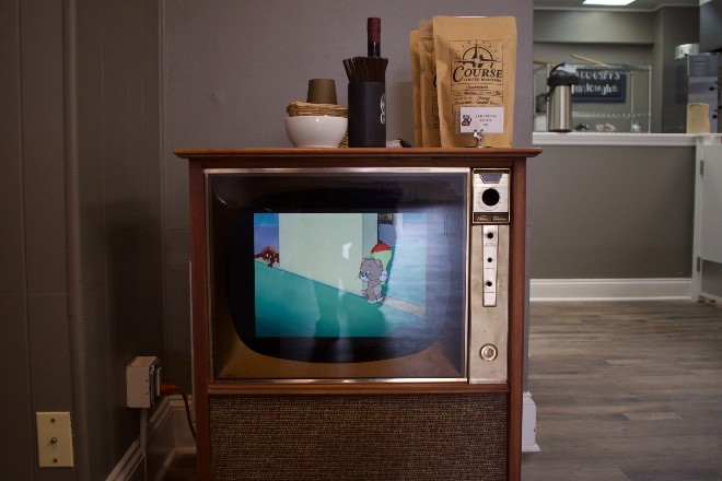 Vintage Tom and Jerry cartoons create a whimsical vibe. - CHERYL BAEHR
