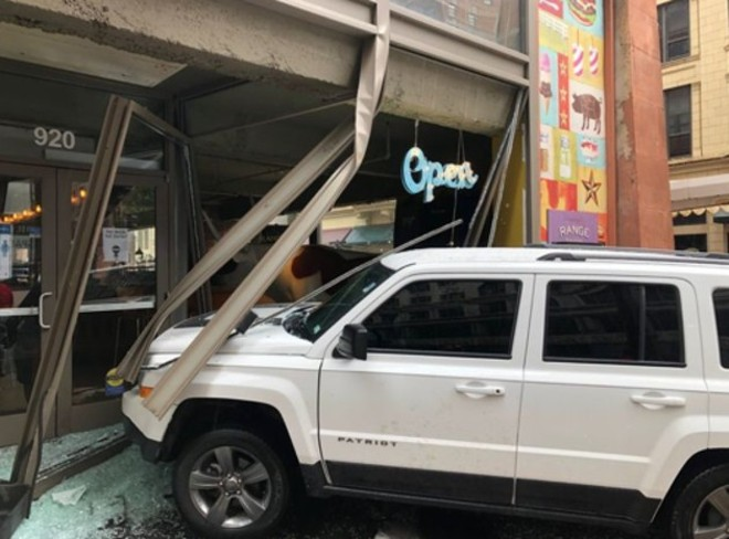 A Jeep slammed through the front windows of Bailey's Range on Saturday morning. - COURTESY OF DAVE BAILEY