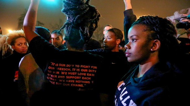 "Ferguson protest leader Brittany Ferrell helped gather people together to chant, ""It is our duty to fight for our freedom,"" during a protest in South St. Louis on Nov. 23, 2014. The chant is based on a quote by Black Power activist Assata Shakur. Before leading the chant, Activist Ashley Yates told the group, ""We know Black lives matter, and we know that we must fight to prove that."" - REBECCA RIVAS/MISSOURI INDEPENDENT"