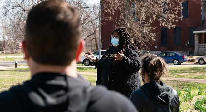 Kayla Reed, executive director and co-founder of Action St. Louis, speaks to a team of volunteers before they began knocking on doors on March 22. They were asking people to support Tishaura Jones, who was elected as the new mayor of St. Louis on April 6. - LAWRENCE BRYANT