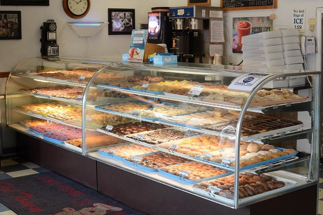 The bakers at Old Town Donuts keep the case stocked 24 hours a day, seven days a week. - ANDY PAULISSEN