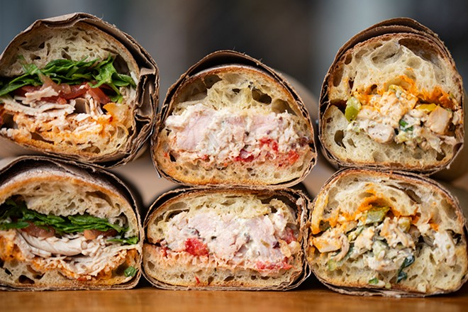 A selection of items from Pastaria Deli & Wine: roasted turkey sandwich, tuna salad and Kris's chicken salad. - MABEL SUEN